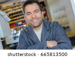 male worker posing | Shutterstock . vector #665813500