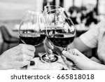 clinking wine glasses black and ... | Shutterstock . vector #665818018