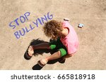 a child wrote stop bullying on... | Shutterstock . vector #665818918