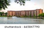 large brick apartment building... | Shutterstock . vector #665847790
