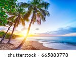 sunset over pearl beach  plage... | Shutterstock . vector #665883778