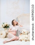 young pregnant girl sitting... | Shutterstock . vector #665900110