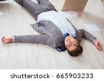 businessman dead on the office... | Shutterstock . vector #665903233