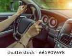 woman driving car | Shutterstock . vector #665909698
