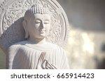 the white stone buddha statue... | Shutterstock . vector #665914423