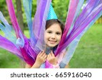 cheerful little girl outdoors   ... | Shutterstock . vector #665916040
