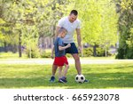 father and son playing football ... | Shutterstock . vector #665923078