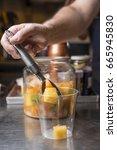 artisan preparation of a glass... | Shutterstock . vector #665945830