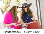 happy woman with shopping bags... | Shutterstock . vector #665946520