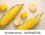 sweet corns. fresh corn on cobs ...   Shutterstock . vector #665968258