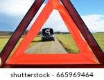 broken car  girl and warning... | Shutterstock . vector #665969464