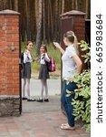 smiling schoolgirls going to... | Shutterstock . vector #665983684