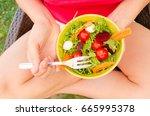 eating healthy food in garden... | Shutterstock . vector #665995378
