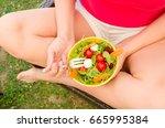 eating healthy food in garden... | Shutterstock . vector #665995384