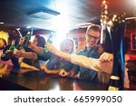 laughing people holding up the... | Shutterstock . vector #665999050