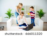 young mother working from home | Shutterstock . vector #666011320