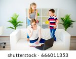 young mother working from home | Shutterstock . vector #666011353