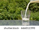 pouring milk into a glass | Shutterstock . vector #666011590