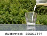 pouring milk into a glass | Shutterstock . vector #666011599