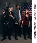 Small photo of US criminal. Gangsters with weapon. Mixed nationality gang on american flag background. Outlaw, ghetto, social problem, robbery concept