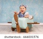 cute little baby girl flying on ...   Shutterstock . vector #666031576