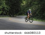 asian men are cycling road bike ... | Shutterstock . vector #666080113