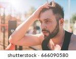 portrait of fatigued fitness... | Shutterstock . vector #666090580