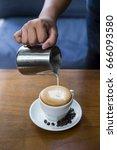 making of latte art coffee | Shutterstock . vector #666093580