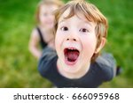 funny little boy shouting and... | Shutterstock . vector #666095968