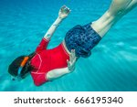 Small photo of Male apnea swims in crystal sea. Underwater background of a man snorkeling and doing free diving. Watersport activity in summer vacations. Tropical destination holidays concept.