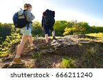 active young couple hiking in... | Shutterstock . vector #666211240