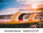 Surfboard On A Beach With...