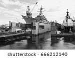 Small photo of Aircraft carrier in the port in Seattle. Profile of a military ship in black and white