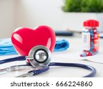 red toy heart and stethoscope... | Shutterstock . vector #666224860