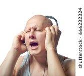 Small photo of Autoimmune total alopecia men love music portrait. Absolute bald joy the music