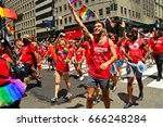 Small photo of New York, NY, USA June 25, 2017 marchers representing the Gay Men's Health Crises march in the 2017 Gay Pride Parade in New York, New York.