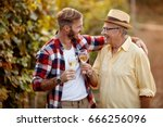 happy father and son tasting... | Shutterstock . vector #666256096