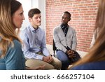 close up of friends comforting... | Shutterstock . vector #666257104