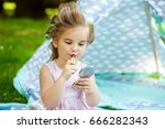 little child draws her lips... | Shutterstock . vector #666282343