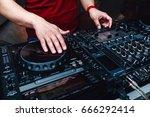 music from vinyl. hands dj... | Shutterstock . vector #666292414