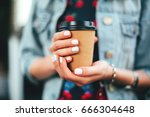 female hand with paper cup of... | Shutterstock . vector #666304648