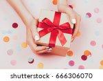 woman hands holding present box ... | Shutterstock . vector #666306070