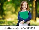 adorable little schoolgirl... | Shutterstock . vector #666308014