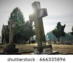 Gravestones And Flowers At The...