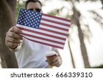 young man showing flag at 4 th... | Shutterstock . vector #666339310