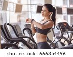 young woman workout in gym... | Shutterstock . vector #666354496