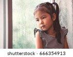 sad asian little girl looking... | Shutterstock . vector #666354913