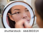 woman putting mascara in ring... | Shutterstock . vector #666383314