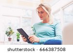 young woman using her tablet... | Shutterstock . vector #666387508