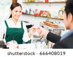 barista is making coffee at his ...   Shutterstock . vector #666408019
